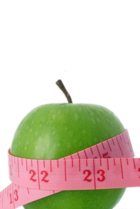 Manzana rodeada de una cinta métrica