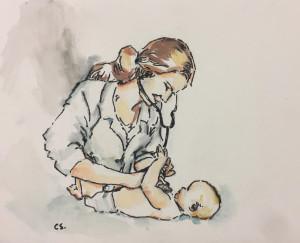 Pediatra explorando a un lactante